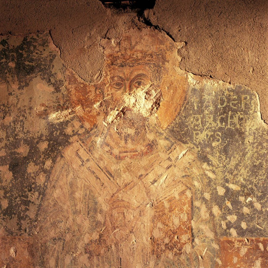 THE FRESCO OF ST. GRISOGONUS, ST. DONAT, ZADAR, FEBRUARY 1992 The face of the saint damaged in shelling